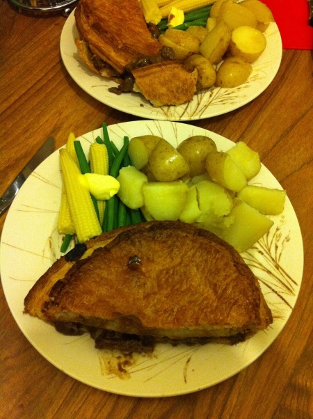 steak pie, potatoes and steamed vegetables